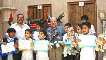 IFAW CEO Fred O'Regan and IFAW Middle East Regional Director Dr. Elsayed Ahmed Mohamed stand with a group of local students in Dubai who received certificates of appreciation for having completed an animal welfare seminar.