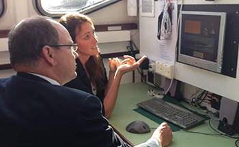 HSH Prince Albert II of Monaco being briefed by IFAW Song of the Whale Senior Scientist, Anna Cucknell.