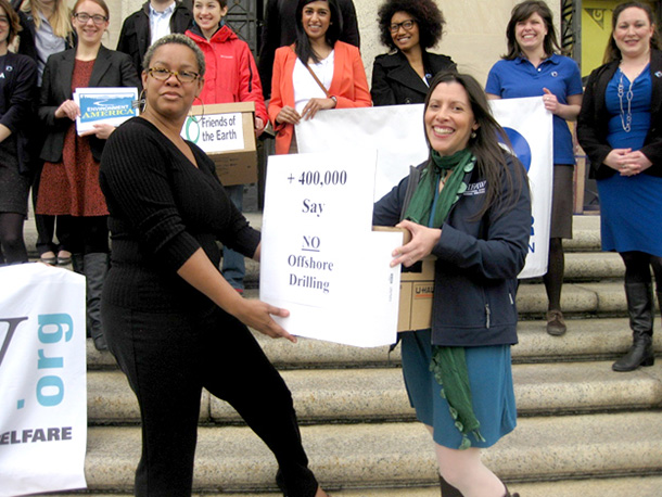 Campaigns Officer, Margaret Cooney, delivering coalition comments to a BOEM representative