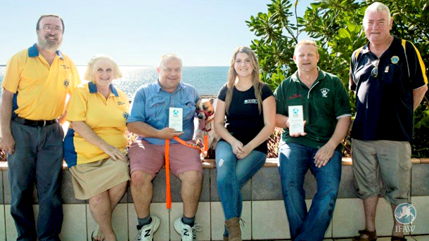 Chris Blackham-Davison (with companion Tamari), Lions Club dog trainer Darren Coldwell (in green shirt), and the author with three other Lions Club representatives.