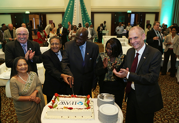 Invited guests cut the cake to mark IFAW EA 15th anniversary