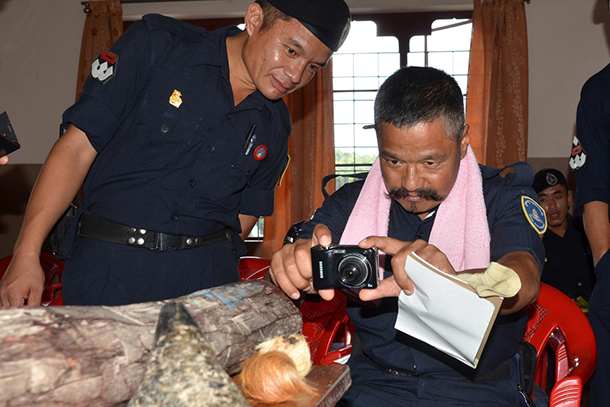 A police officer takes a picture