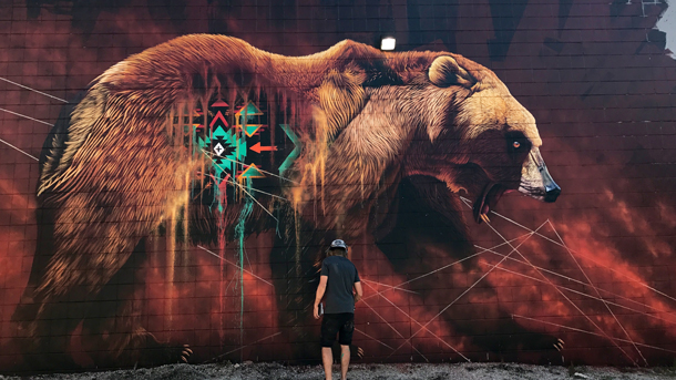 Sonny completed his mural of a grizzly bear this July in Cambridge, Ontario.