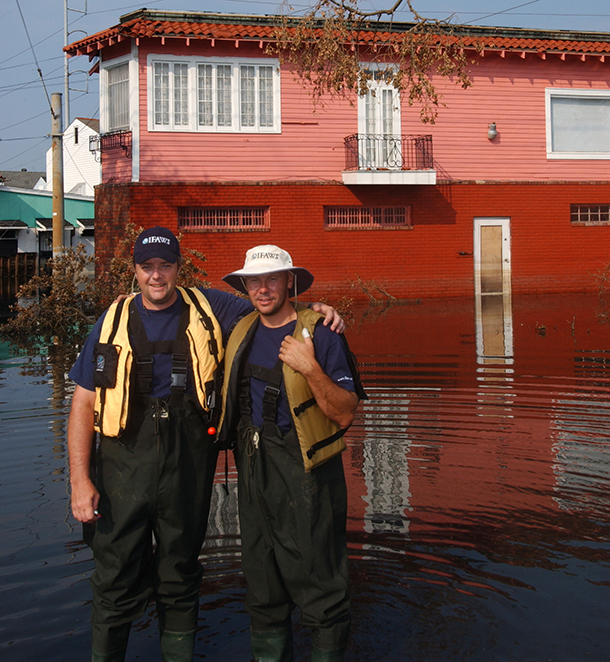 Camera men Chris Nickless and Stewart Cook in flood waters following Hurricane Katrina.