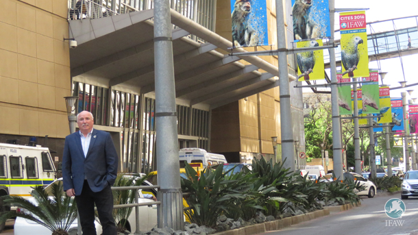 The author outside the  Sandton Convention Center in Johannesburg under the IFAW banners.