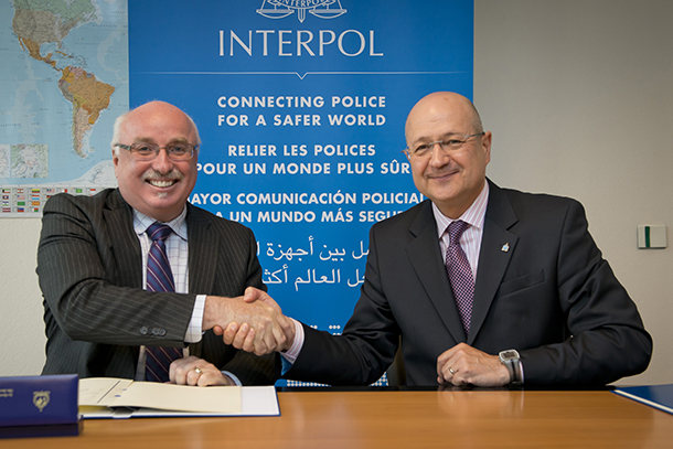 The author with INTERPOL's Executive Director of Police Services Jean-Michel Louboutin signing an MoU at Interpol's headquarters in Lyon, France.