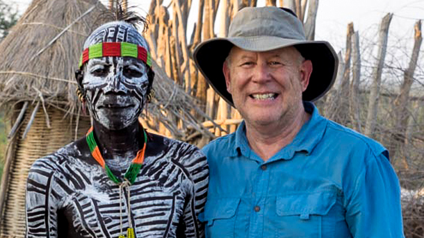 Frank Binder, the winner of our World of Animals calendar photo contest, poses with a local on one of his trips to Africa.