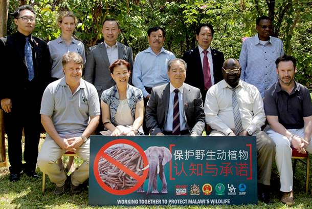 Left to right (front): Mr Mark Sprong, Chairman, Lilongwe Wildlife Trust; Madam Nan Xinrong; His Excellency Zhang Qingyang, Chinese Ambassador; Mr Ben Botolo, Principal Secretary Ministry of Natural Resources, Energy & Mining; His Excellency, Michael Nevin, British High Commissioner.  Left to right (back): Mr  Wang Jiaxin, Economic Counsellor of the Embassy; Ms Kate Moore, Programmes Director, Lilongwe Wildlife Trust; Mr Lai Xing, Political Counsellor; Mr Zhou Shanjian, Chairperson of Lilongwe Chamber of Commerce of the Chinese Businesspersons; Mr Jiang Qingxi, Chairperson of Blantyre Chamber of Commerce; and Mr Brighton Kumchedwa, Director of Parks & Wildlife.