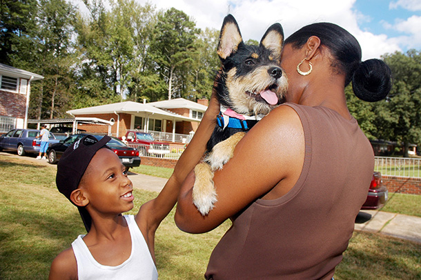Coco, an 8 month old terrier is reunited with her family in Georgia after being separated during Hurricane Katrina. Oct. 1, 2005 ©IFAW