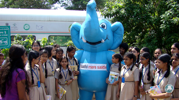 School children gather around Gaju, an inflatable Gaj Yatra mascot, at the Biodiversity Express during CBD.