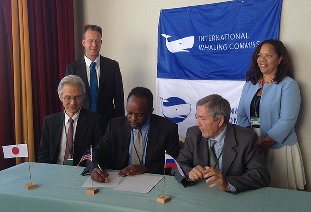 With IWC Officials looking on, US IWC Commissioner Russell Smith, Japan's Joji Morishita and Russia's Valentin Ilyushenko sign a new cooperative agreement to protect Western Gray Whales.
