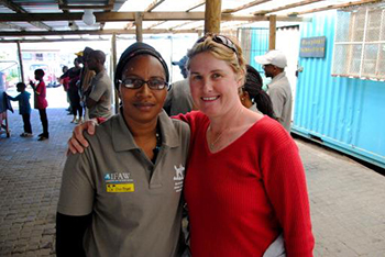 A new office for the animal hospital in Mdzananda, South Africa, was opened in September 2013. Photo: Animal Welfare Assistant Maria Limani with IFAW's Lisa Cant-Haylett. © IFAW/L. Cant-Haylett