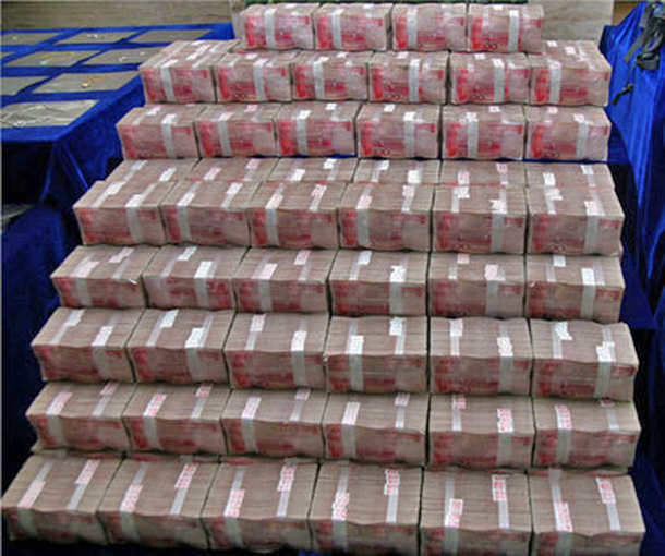 Thousands in Chinese currency were recently seized after being discovered in the hidden cache of a government official.