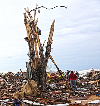 Survivors of the Moore, Oklahoma tornado comb through the debris. c. IFAW/Stewart Cook
