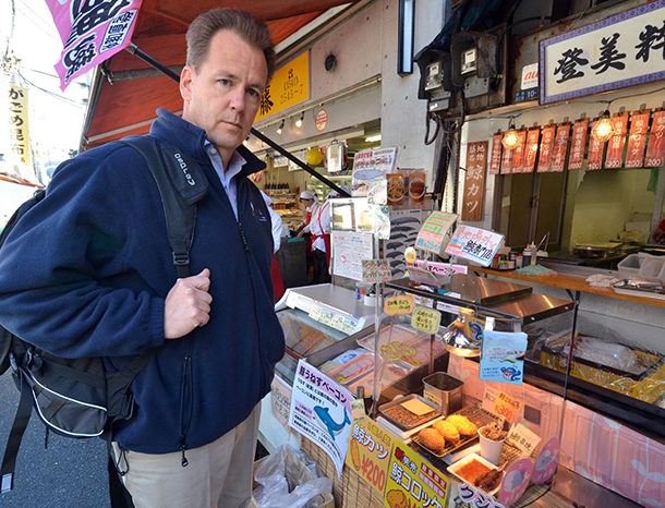 The author at a Japanese market selling whale meat, a dying industry that the Prime Minister still supports despite World Court rulings.