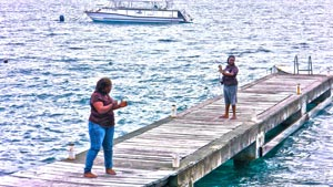 Teachers on the pier with a whale size reel.