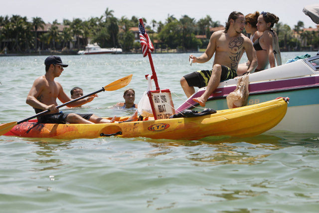 Miami Beach, FL: Family Business Uses Kayaks to Deliver Hot Dogs to Hungry Boaters