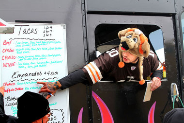 Brian Finks, chef owner of the Fired Up Taco truck, helps customers decide what to order. Browns fans and food afficionados gathered for the Browns/Chiefs watch party, dubbed Touchdown Chowdown, on Sunday, December 9, at Mavis Winkles in Independence.