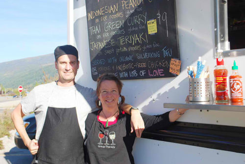 Lesley Clint (right) and David Havemann (left) run the Manamana food truck that is parked on the Lakeside Drive during the summer in Nelson. The couple says more trucks want a piece of the Nelson action. Megan Cole photo