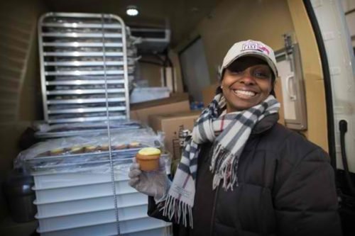 """Tracy A. Woodward/The Washington Post -  Aliyyah Baylor stands with her pastry truck, Make My Cake. """"I thought I hit the Lotto jackpot,"""" Baylor said of finding out her truck would be located at 14th Street and Pennsylvania Avenue on Inauguration Day."""