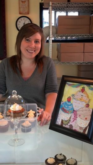 Stephanie Scott, assistant baker for Abby's Cookies and Cupcakes, operates a popular sweet stop after a hearty lunch in downtown Olympia.