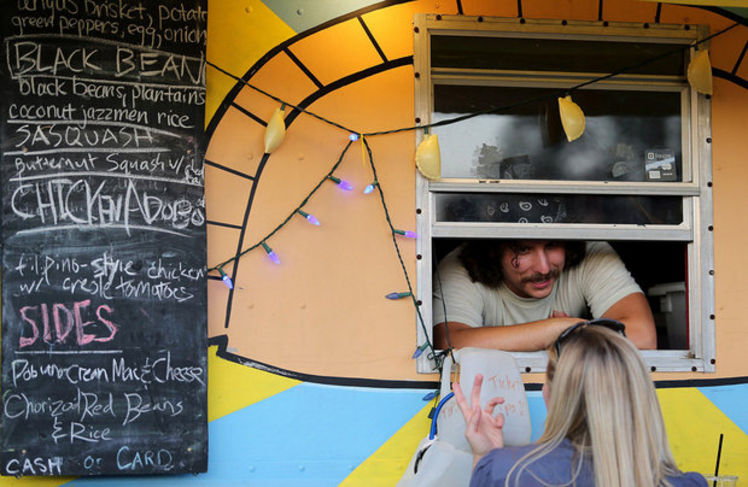 Tandrey Taylor Jackson of Empanada Intifada takes a order during the Central City Food Truck Fest in the 2000 block of Oretha Castle Haley Blvd. on Oct. 11, 2012. (Photo by Michael DeMocker, NOLA.com / The Times-Picayune)