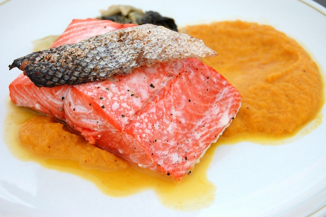 (WBEZ/Louisa Chu)Roasted wild sockeye salmon with carrot coriander sauce by Emmer & Rye chef/owner Seth Caswell at the Sitka Seafood Festival in Sitka, Alaska