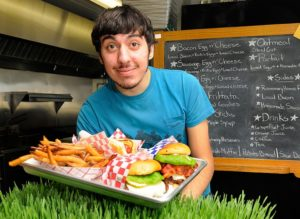 Art Gentile Evan Asoudegan, 19, has opened MOO restaurant in Ottsville, serving up American classic food made with ingredients sourced from local family farms.