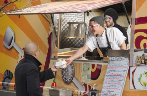 Clement Chan and chef Kris Girard serve up Asian dishes from Le Tigre food cart at 8th and Cambie on Tuesday, Feb. 12. Photograph by: Gerry Kahrmann , The Province