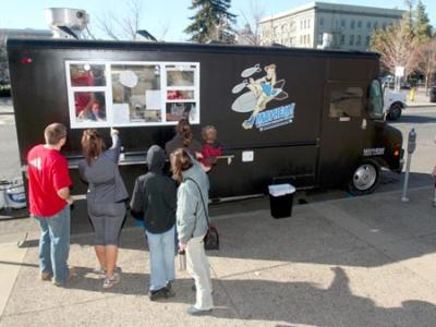 Upscale food trucks are starting to take hold in the Chico area. In this photo taken Jan. 21, the Mayhem Gourmet Grilled Cheese truck is seen along Main Street with customers waiting in line.(Ty Barbour/Staff File Photo)