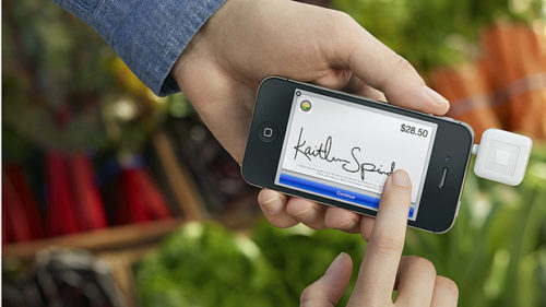 Merchants can turn their smartphones into registers using the Square credit card reader and having customers sign with their finger. (Square)
