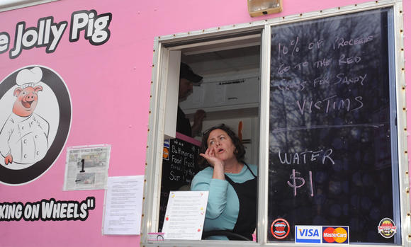 Joann Calwell, owner and sous chef of The Jolly Pig, calls a customer's name for their order during a November 2012 food truck rally in Towson. (Baltimore Sun Media Group Photo / November 8, 2012)