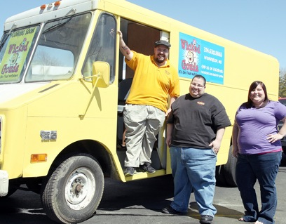Wicked Gouda on Wheels This Wicked Gouda food truck will soon offer unique grilled cheese sandwiches and cupcakes from its traveling kitchen. The owners of Big Boy's Grilled Subs & Wings and Flour Power will run the truck. From left are Mike Aiello and Lenny Aiello, Big Boy's owners, and Sara Hannel, Flour Power owner. The truck is expected to begin Washington and Union routes in mid-April.  Missourian Photo.