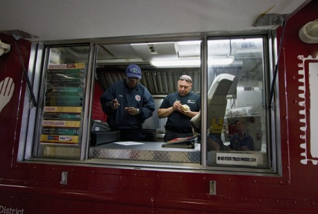ALEX HOLT | DISPATCH Thomas Hill, left, of the Columbus Division of Fire reads through an inspection list with Ben Cloose in the Foodie Truck. The inspection is part of a pilot program the city is developing to more closely regulate the city's estimated 150 food trucks.