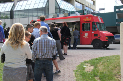Customers line up outside the Perogy Boyz food truck last summer in this file photo.