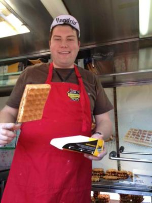 Belgium native Erwin Vandenabeele serves up a hot waffle from the popular Wafles and Dinges truck. Photo by Katrina Woznicki / Lonely Planet.