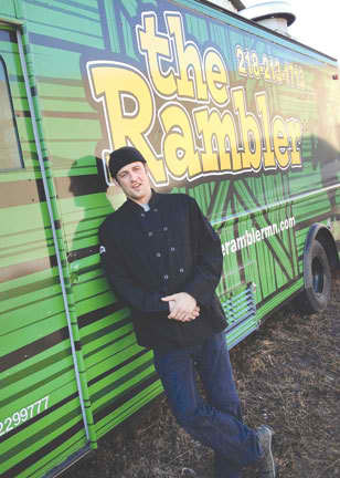 """Jonathan Reznick of Duluth stands beside his food truck, """"The Rambler."""" He said he welcomes rules being set by the city for mobile food trucks. He began doing business in Duluth in 2012. (Photo courtesy of Jonathan Reznick)"""