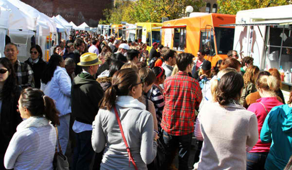 Food trucks line up at the SOWA Open Market. Credit Chris Masci