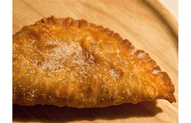 Deep-fried pie: Homemade pie crust is filled with your choice of pie filling before it is wrapped, deep fried and sprinkled with cinnamon sugar. Soft service ice cream is available to top it all off. Photograph by: Courtesy, Calgary Stampede