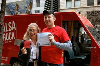 Rosemary Krimbel, the city's chief of Business Affairs and Consumer Protection, presents Dan Salls with a license to cook food on his Salsa Truck, the first in the city so honored. (DNAinfo/Lizzie Schiffman)