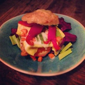 """""""Chegg it out,"""" Buffalo chicken & bleu cheese dressing with scrambled egg patty and chopped celery on a homemade cheddar buttermilk biscuit"""