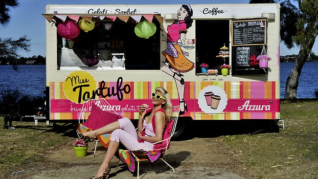 Karina White relaxes in front of a Miss Tartufo gelato truck. Picture: Richard Hatherly