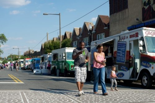Food trucks are lined up as OARC and the Food Trust host Thursday's Night Market event at Ogontz Avenue in West Oak Lane. (Bas Slabbers/for NewsWorks)