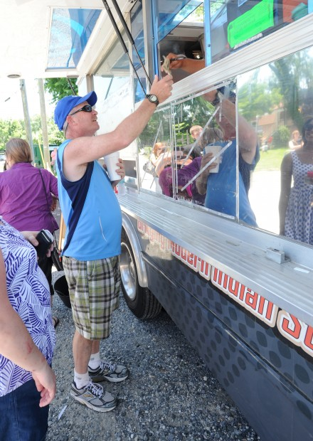 Tom Thornhill, from Glen Burnie, pays for his meal and is then told it could be 20-30 minutes before it was done. The Tikka Tikka Taco truck was at the Annapolis Yacht Club's Annex. Three competing trucks from Food Network's The Great Food Truck Race stopped in Annapolis Friday afternoon.