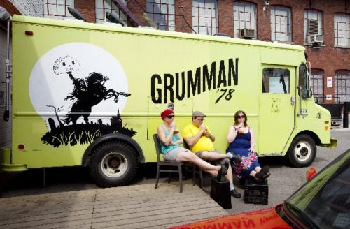 Gaëlle Cerf, left, Marc-André Leclerc and Hilary McGown take a break outside the Grumman 78 food truck last year: When he worked the 2010 Jazz Festival, Leclerc and his team served tacos from his food truck for adoring crowds for up to 16 hours a day. Photograph by: Dario Ayala , THE GAZETTE
