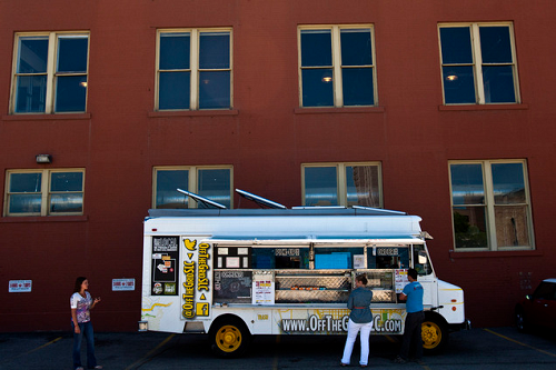 (Chris Detrick | The Salt Lake Tribune) Customers order food from Off the Grid's food truck parked near 200 South and 200 West Wednesday June 5, 2013.