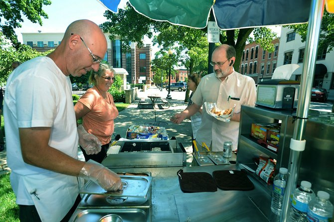 - Monroe News photo by TOM HAWLEY Dog Pound traveling standMonroe News photo by TOM HAWLEY Cheri Sicuso owner of The Dog Pound, a traveling vendor, and her brother Scott Smith sell a couple of hotdogs to Steve Sontag down at Loranger Square Thursday afternoon.