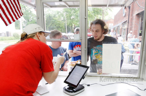 Jessica Noto served Jordan Todd at Mia Nonni food truck outside West Sixth Brewing Company in Lexington, Ky., on May 16, 2013. Photo by Pablo Alcala | Staff PABLO ALCALA — Lexington Herald-Leader