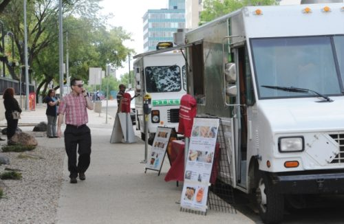 Two food trucks set up Monday at 107th Street and 100th Avenue in Edmonton.