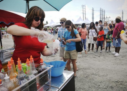 From Baltimore: Hula Honey's Maggie Sabo of Hula Honey's Hawaiian Shaved Ice of Baltimore prepares a snow cone for a customer at A Taste of Two Cities, a food truck rally pitting Baltimore against D.C. for taste supremacy. (Gabriella Demczuk /June 23, 2012)